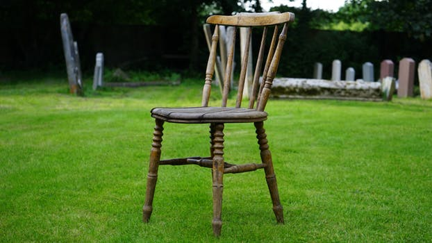 Empty chair and grave